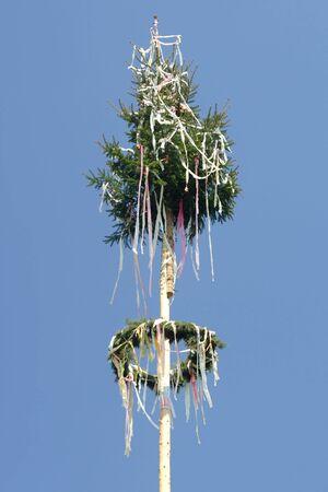 May pole on sky background photo