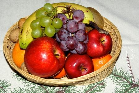 fruit basket: Big fruit basket at Christmas time Stock Photo