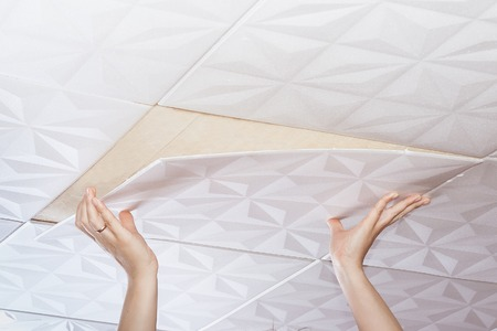 ceiling: Installation of ceiling tiles made of polystyrene