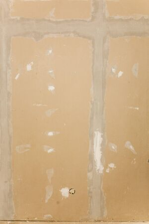 taping: A or drywall background, the taping and spackling have been done in this shot.