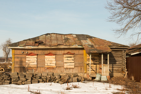 boarded up: old farmhouse with a boarded up window boards Stock Photo