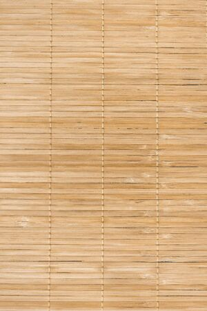 Full frame background of natural unpainted bamboo wood board, natural wood, Texture of wooden slats. Many beige planks on the photo. vertical Foto de archivo