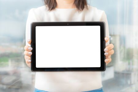 Women hold and digital tablet device, female hands show the tablet , front view, mockup Stockfoto
