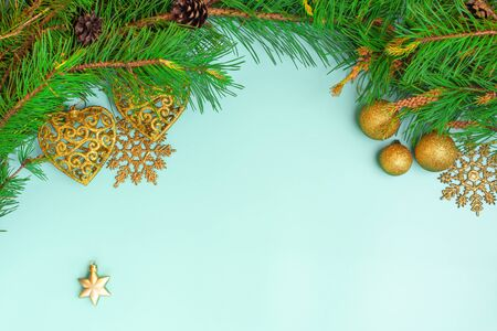 Christmas decoration. Branch christmas tree, christmas balls and chrismas star. New Year. Top view, flat lay