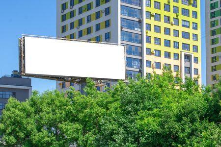 Blank billboard in a city with building background. Empty or blank advertisement billboard to put your design on it.