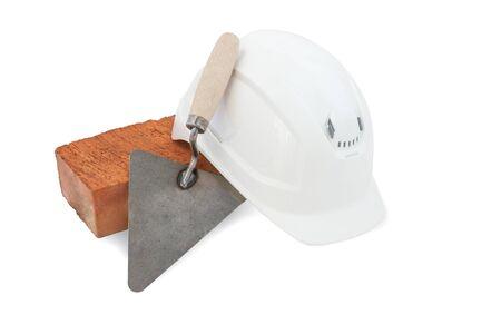 Bricklayer tools. Mason tools - Trowel, bricks and white hardhat isolated on white background