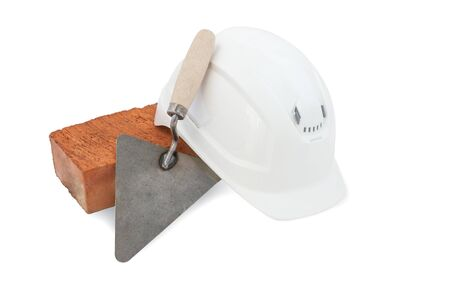 Bricklayer tools. Mason tools - Trowel, bricks and white hardhat isolated on white background