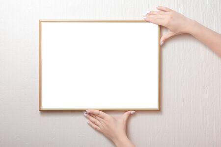 hanging a photo frame mockup on a white wall. Picture frame mockup Foto de archivo