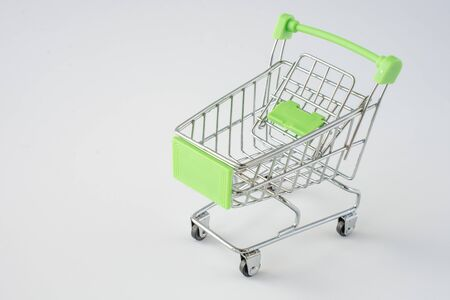 Small shopping cart on gray background. shopping concept. space for text