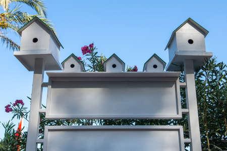 bird houses against the blue sky.bird houses against the blue sky. beautiful white birdhouses on clear sky background. summer. copyspace