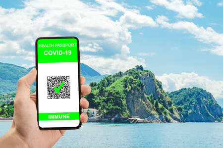 digital qr immunity covid-19 health passport. Safe travel concept. Phone with health passport and COVID-19 test result, concept of new normal for travelers. Close up view Foto de archivo