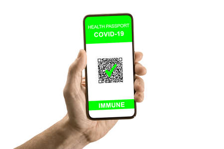 Hand hold cell phone with vaccine passport isolated on white. Safe travel concept with health passport and COVID-19 test result, concept of new normal for travelers. Digital International Certificate