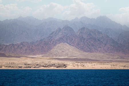 red sea and sinai mountains. incredible landscape sea mountains amazing clouds in the sky. Egypt, Dahab, Sinai Peninsula. Red sea.