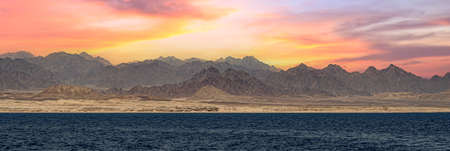 Sunset in Sinai Mountains, Egypt. panorama of the Sinai mountains on a stunning sunset. colorful landscape. Wonderful solar Red Sea. Bible Landscape - Sinai And Red Sea