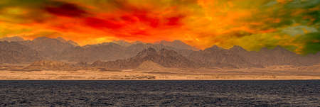 coast of the red sea with the Sinai mountains in Egypt. Bible Landscape - Sinai And Red Sea. Sunset in Sinai Mountains, Egypt. Red sea Sinai mountains sea panoramic landscape