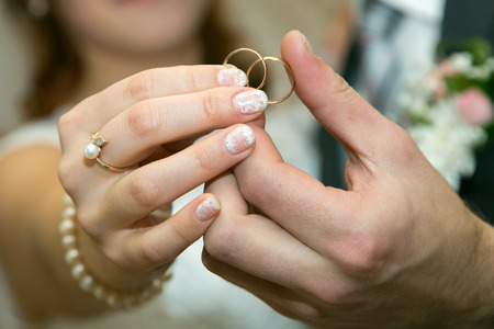 life partners: Wedding rings in arms