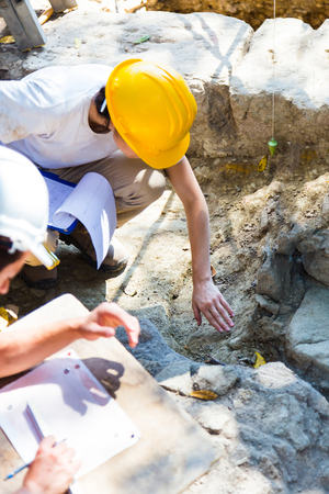 archaeologists: Archaeologists digging ruins Stock Photo