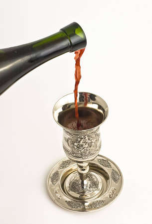 kiddish: filling ritual wine cup in the Sabbath Stock Photo