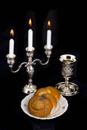 Candlestick a cup and bread on a black background Stock Photo - 4109933