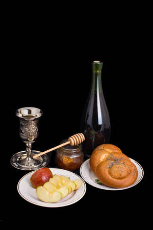 Apples and honey are symbols of the Jewish new year photo