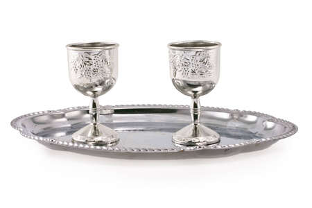 kiddush: silver cup on silver tray on white background