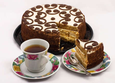 a cup of tea with a piece of cake. photo