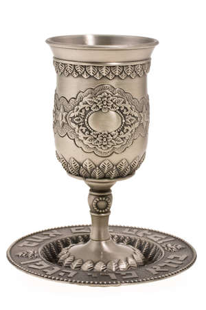 rosh: Silver kiddush wine cup and saucer isolated