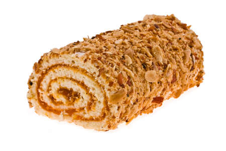 Roulade with apricot jam and nuts on a white background photo