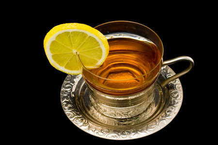 4122780-transparent-cup-with-tea-and-a-lemon-on-a-silver-dish.jpg