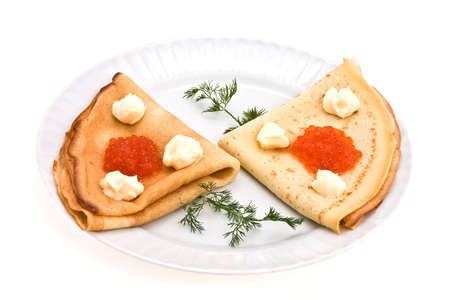 plate with pancake with roe and mask decorated by dill photo