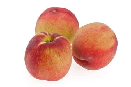 three ripe bright peaches on white background photo