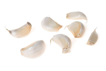 pungent: Segments of a head of garlic on a white background Stock Photo