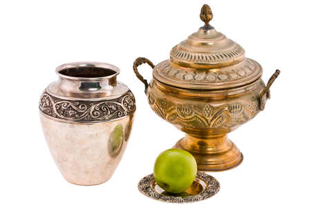 antique dishes: antique dishes and apple on white background