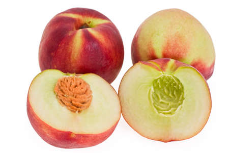 ripe peaches integer and halfs on white background photo