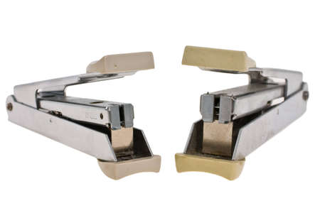 Stapler for papers on a white background photo