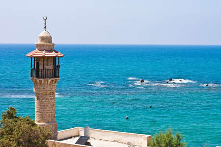 minaret to old mosque ashore mediterranean epidemic deathes photo