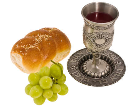 judaica: ritual cup, muffin and grape on white background