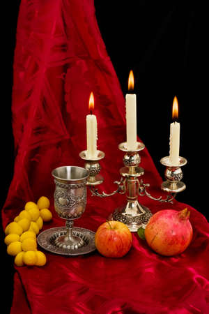 judaica: traditional festive cup and fruits on white background