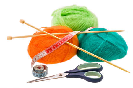 Multi-coloured woolen a thread for knitting on a white background photo