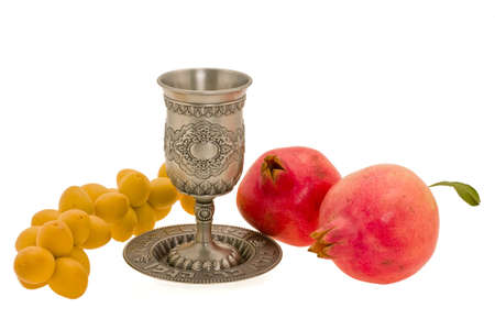 traditional festive cup and fruits on white background photo
