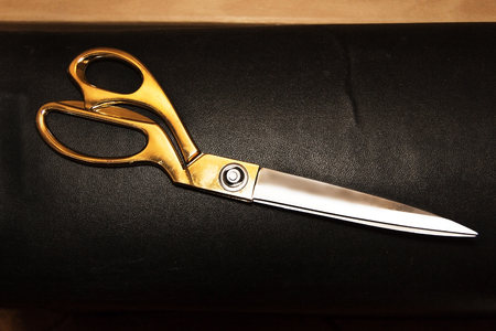 genuine leather: Vintage scissors on the background of genuine leather Stock Photo