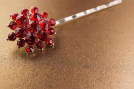 hairpin for hair on a golden background