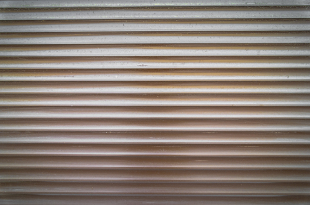 Teal brown painted horizontal metal window roller shutter blinds or garage doors background texture. Stock Photo