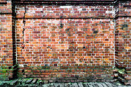 Brick wall of red orange color background. Vintage old masonry. Banque d'images