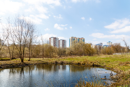 Abandoned park in the center of the city in early spring in warm sunny weather