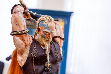 battleground: Ancient dolls of Scandinavian gods and monsters, Thor, Heimdall, witches, griffin, dragon Stock Photo