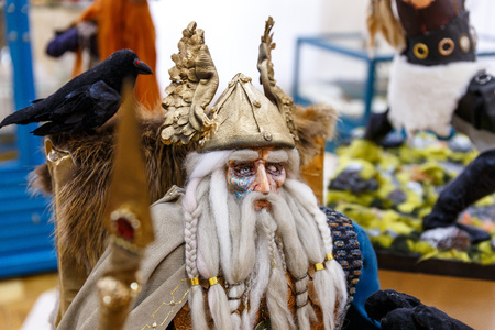 Ancient dolls of Scandinavian gods and monsters, Thor, Heimdall, witches, griffin, dragon Stock Photo