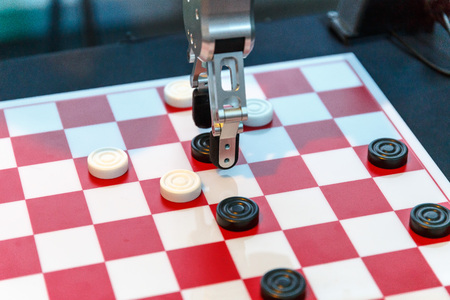 High-tech robot plays checkers at an exhibition of robotics Stock Photo