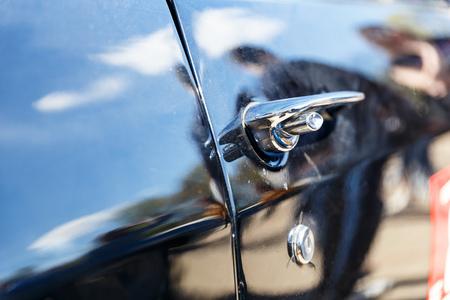 rusty car: Beautiful old classic or retro car door handle Stock Photo