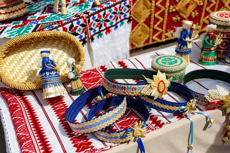 muñecas rusas: Dolls toys tableware clothes handmade souvenirs at the exhibition of folk arts